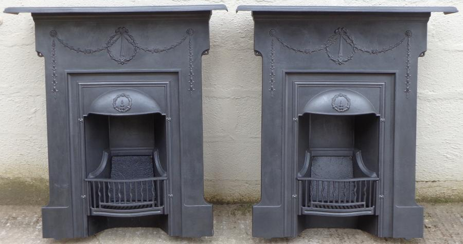 A matching pair of antique cast iron  combination fire grates.