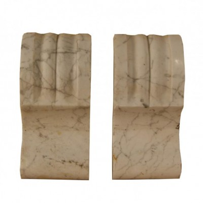 A pair of 19th century carved Carrara marble corbels
