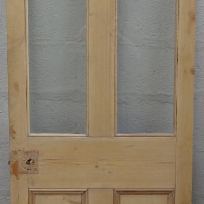 Victorian  part glazed pine door.