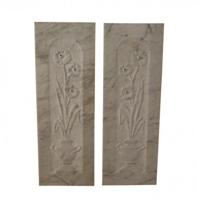 A pair of late 19th century carved Carrara marble panels