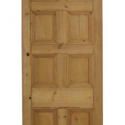An eight panel pine front door