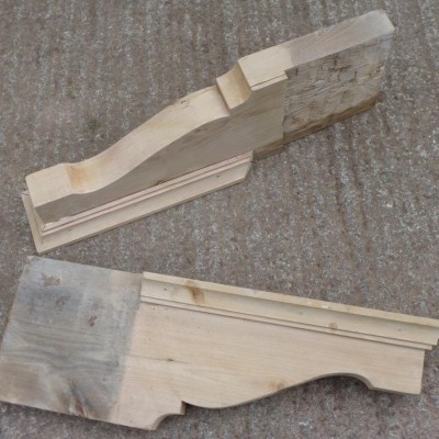 A pair of pine Victorian canopy brackets.
