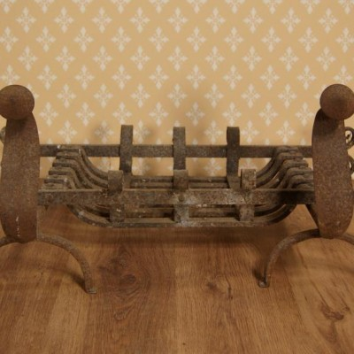 A 19th century wrought iron fire basket / dog grate