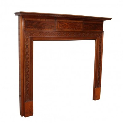 An Inlaid bow fronted flame Mahogany fire surround