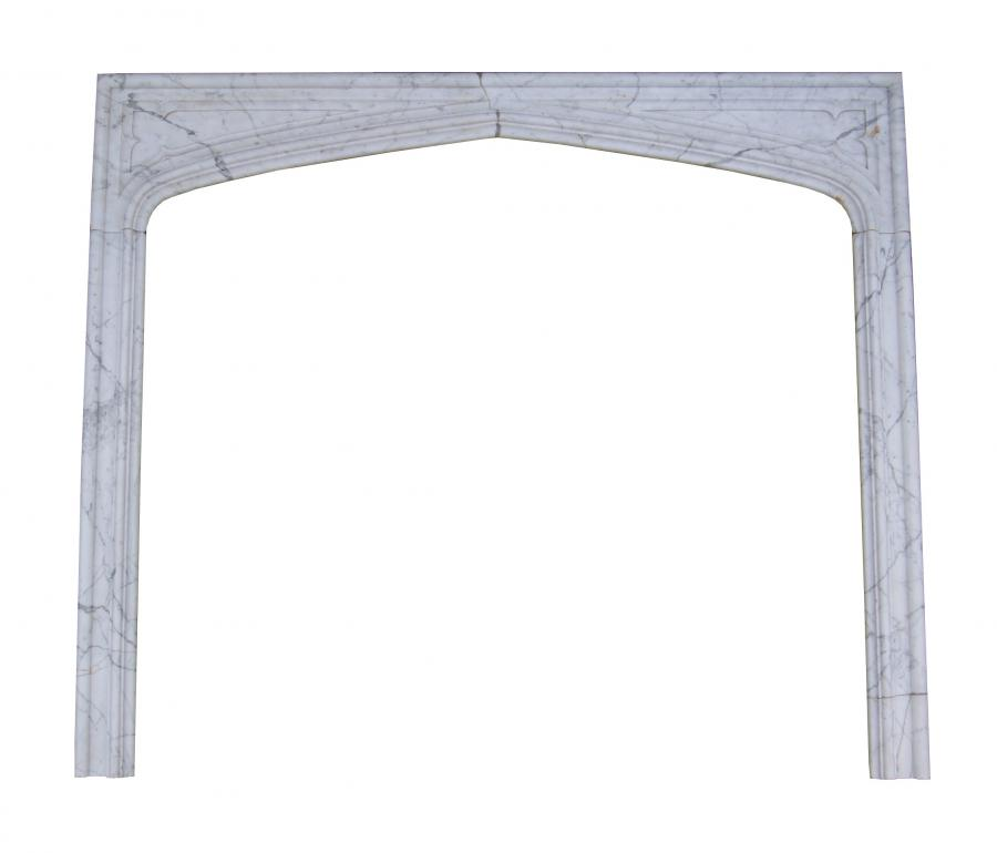 A set of Victorian Gothic Carrara marble fireplace slips