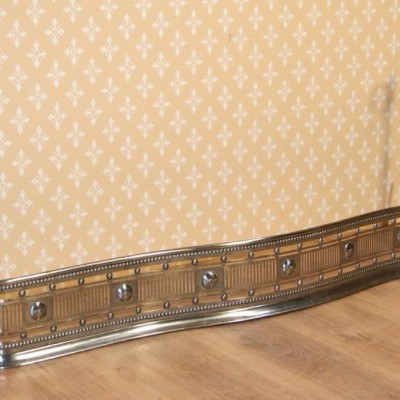 Early 19th century polished and engraved steel fireplace fender