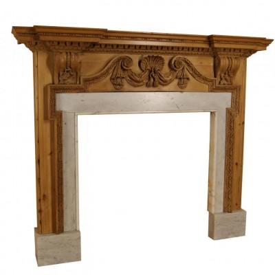 Early 19th C. carved pine chimneypiece with Carrara marble slips