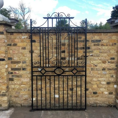 Two Reclaimed Wrought Iron Gates