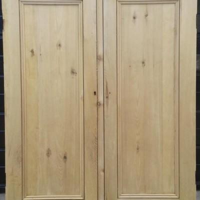 Pair of Victorian rebated paneled cupboard doors in pine.