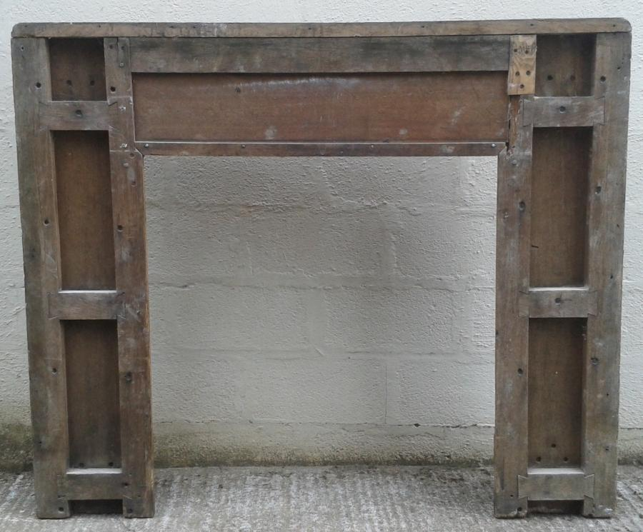 Antique solid oak fire surround.
