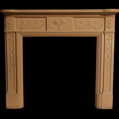 A late 19th century painted pine and gesso fire surround